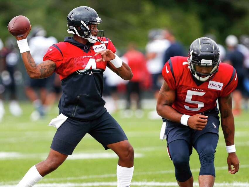 Houston Texans quarterback Deshaun Watson (4) throws a pass after faking a handoff to quarterback Joe Webb (5) during training camp at the Greenbrier Sports Performance Center on Tuesday, July 31, 2018, in White Sulphur Springs, W.Va.