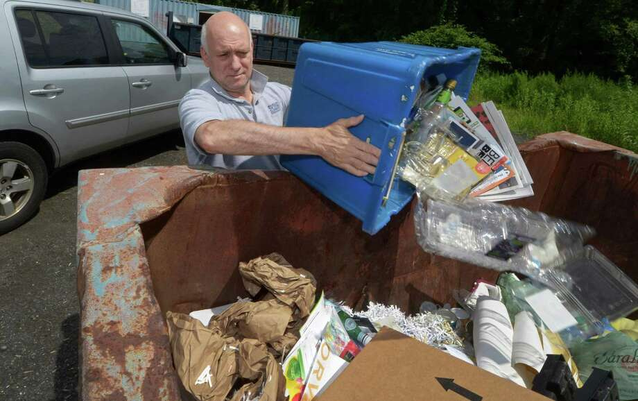 Wilton resident Johnn Psaltos dumps recyclable material at The Wilton Transfer Station Thursday, July 26, 2018, in Wilton, Conn. The Wilton Transfer Station could be negatively affected by a ban on contaminated recyclables in China. Photo: Erik Trautmann / Hearst Connecticut Media / Norwalk Hour