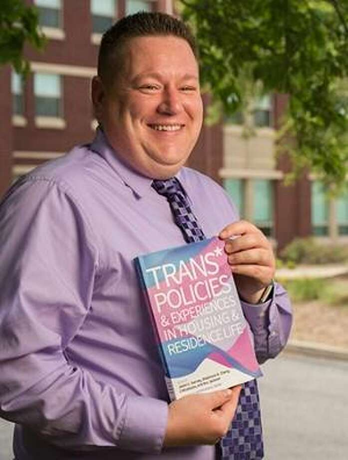 Rex Lee Jackson, SIUE associate director of Residence Life and one of four editors of the book, Trans* Policies & Experiences in Housing & Residence Life. Photo:       For The Telegraph