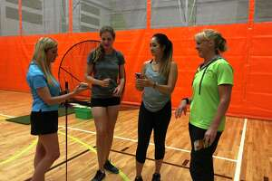 Joyce Bassett / Times Union Christina Weden, far left, of Schenectady, who just started playing golf at age 41, attends a clinic on golf fitness at Vent Fitness in Guilderland. Symetra Tour players, from left, Victoria Morgan and Gabriella Then and Beth Skinner, far right, master trainer at Vent, instructed the clinic.