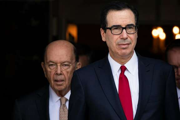 Treasury Secretary Steven Mnuchin, right, and Commerce Secretary Wilbur Ross walk out onto the South Portico before President Donald Trump spoke about the economic growth report, at the White House in Washington, July 27, 2018. The Trump administration is considering bypassing Congress to grant a $100 billion tax cut mainly to the wealthy, a legally tenuous maneuver that would cut capital gains taxation and fulfill a long-held ambition of many investors and conservatives. (Samuel Corum/The New York Times)