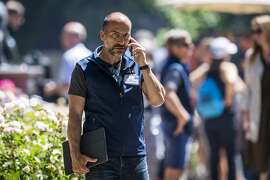 Dara Khosrowshahi, chief executive officer of Uber Technologies Inc., speaks on the phone after the morning session at the Allen & Co. Media and Technology Conference in Sun Valley, Idaho, U.S., on Friday, July 13, 2018. The 35th annual Allen & Co. conference gathers many of America's wealthiest and most powerful people in media, technology, and sports. Photographer: David Paul Morris/Bloomberg