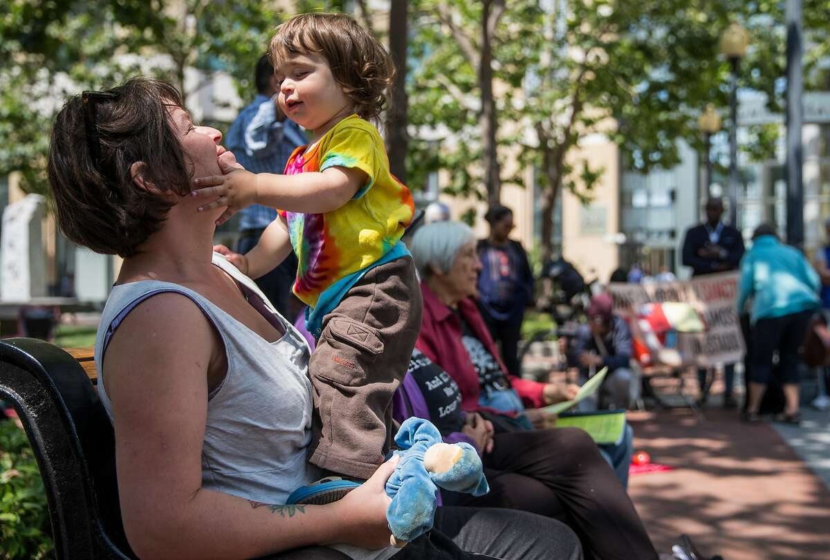 Sarah Norr of Oakland shares a moment with her son Rowan, 16 months, during the second day of a three-day hunger strike in front of the Oakland Federal Building in Oakland, Calif. Tuesday, July 31, 2018 hosted by Bay Area mothers protesting the separation of families at the border.