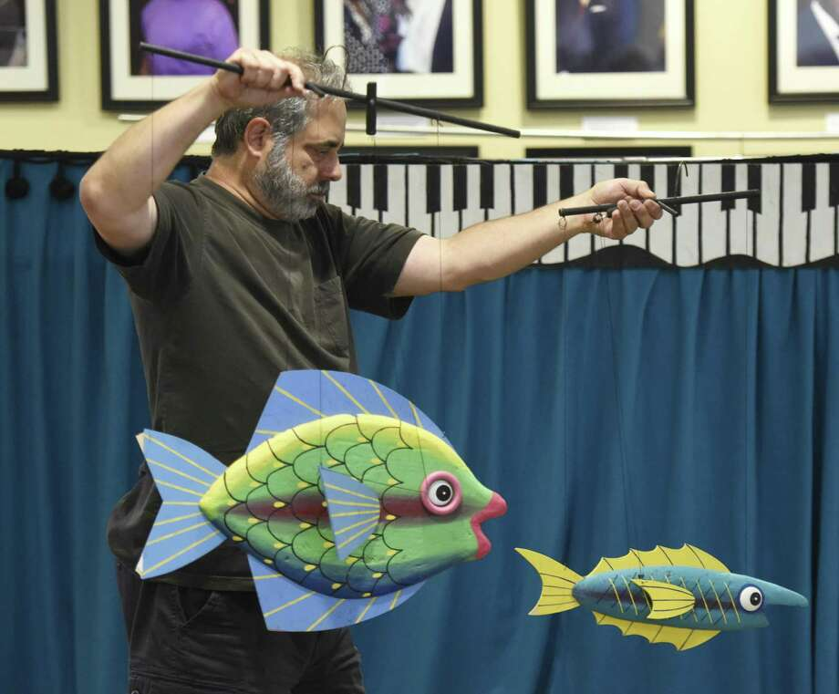 "Puppeteer Robert Rogers presents ""Carnival of the Animals"" at Byram Shubert Library in the Byram section of Greenwich, Conn. Tuesday, July 31, 2018. A packed house of kids marveled at the puppetry skills of Rogers as a variety of animals hopped, flew, swam and ran along to the music of Camille Saint-Saens's ""Carnival of the Animals."" Photo: Tyler Sizemore / Hearst Connecticut Media / Greenwich Time"