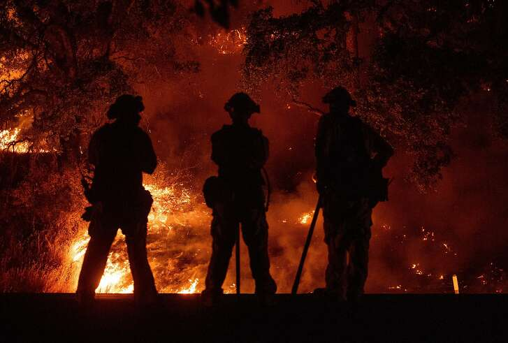Firefighters at the Mendocino Complex fire.�California has been using inmate firefighters to fight a series of large and complex fires all over the state. A new program partially fixes a big problem with the practice -- the inmate firefighters haven't been allowed to work in fire departments after their release from prison.
