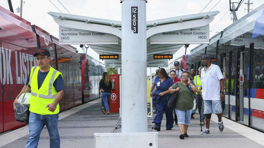 Riders disembark a Metropolitan Transit Authority Red Line light rail train at the HCC Northline Commons station on Fulton Street near E. Crosstimbers Street on July 30 in Houston. Metro has discussed extending the Red Line at least to Tidwell Road. Photo: Mark Mulligan, Staff Photographer / Houston Chronicle / © 2018 Mark Mulligan / Houston Chronicle