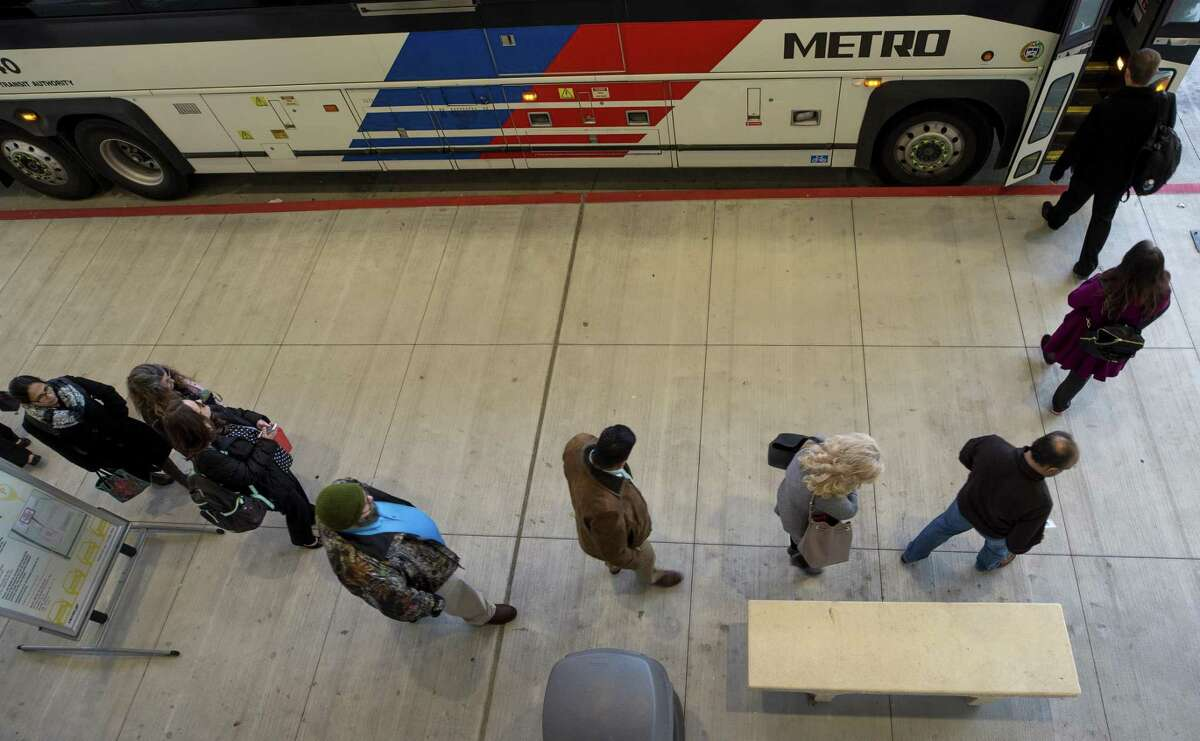 Commuters board a Metropolitan Transit Authority commuter bus heading to downtown Houston at the Grand Parkway Park and Ride on Jan. 4 in Katy. Future plans rely on heavy investment in commuter bus service.
