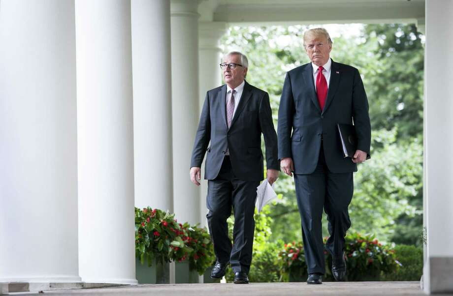 President Donald Trump walks with Jean-Claude Juncker, the European Commission president, at the White House July 25. Trump announced a truce and negotiations with the EU. Photo: DOUG MILLS /NYT / NYTNS