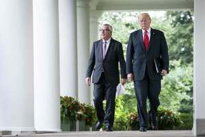 President Donald Trump walks with Jean-Claude Juncker, the European Commission president, at the White House July 25. Trump announced a truce and negotiations with the EU.