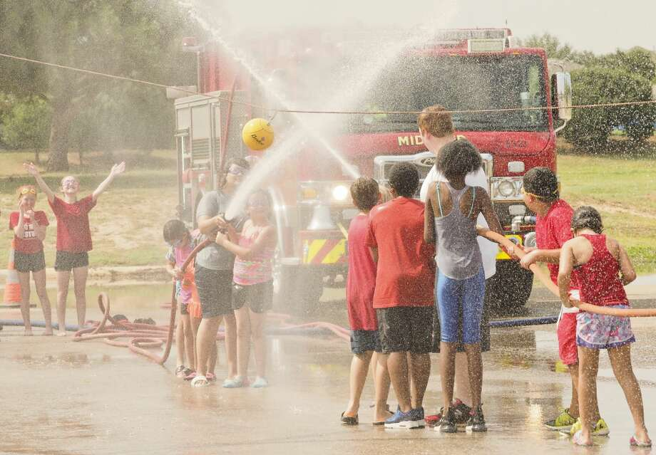 Midlanders cool off with a game of fire fighter water polo during the 2018 Wellness Tour kicks off 07/31/18 with the MFD Wet 'n Wild fun at CJ Kelly Park. Tim Fischer/Reporter-Telegram Photo: Tim Fischer/Midland Reporter-Telegram