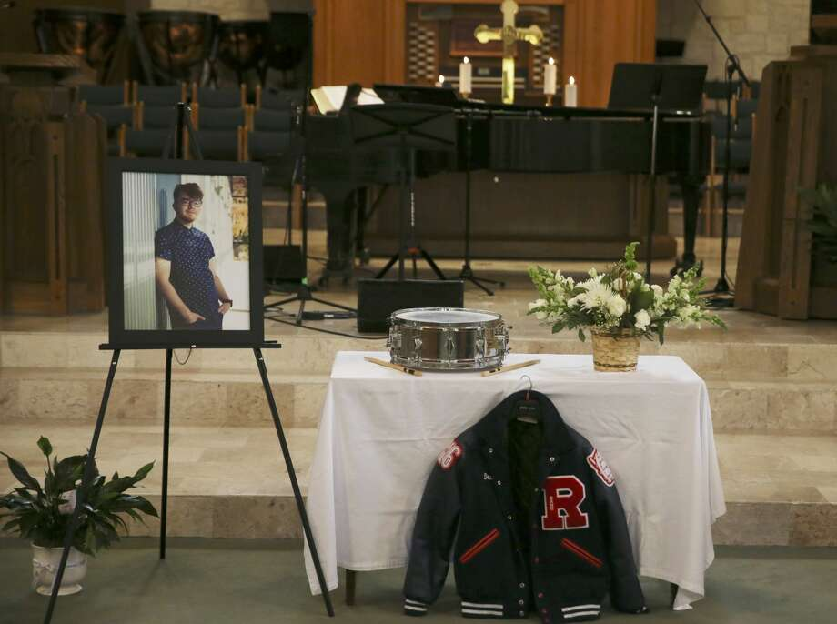 A portrait and personal belongings were placed by the altar for Dru Estes' memorial service at the University United Methodist Church on DeZavala Road, Tuesday, July 31, 2018. Estes, 20, is one of five people killed in the Iconic Village Apartments fire in San Marcos, Texas on July 20. Photo: JERRY LARA/San Antonio Express-News
