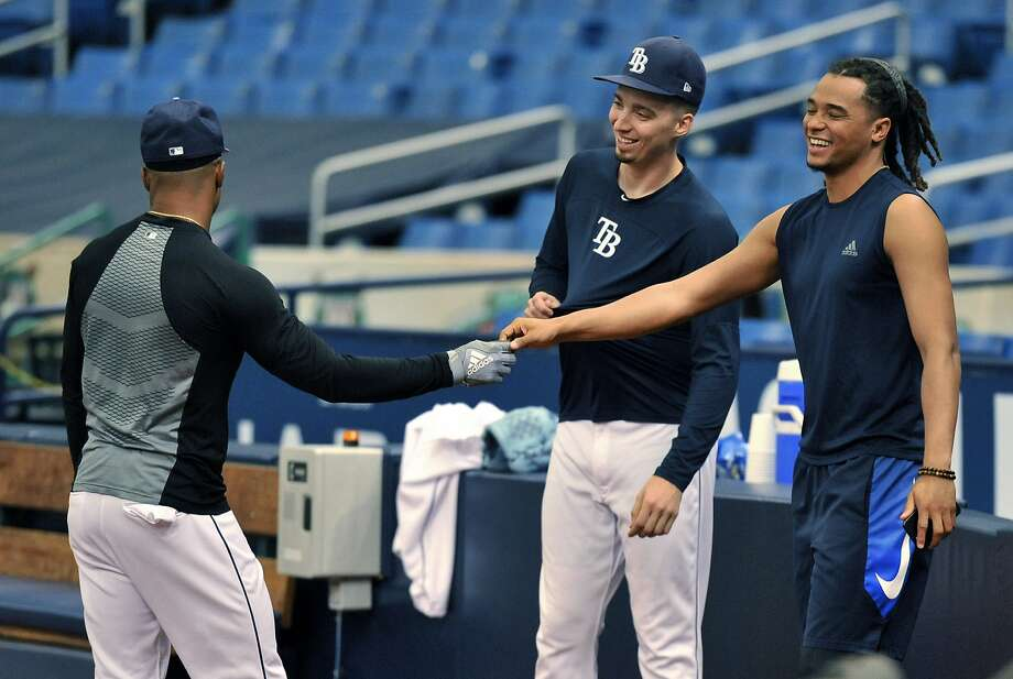 Tampa Bay Rays' Chris Archer, right talks with Mallex Smith, left, and Blake Snell, center, in the bullpen after he was traded to the Pittsburgh Pirates Tuesday, July 31, 2018, in St. Petersburg, Fla. The Pirates bolstered the front end of their rotation at the non-waiver deadline, adding Archer while sending the Rays a couple of coveted prospects in outfielder Austin Meadows and pitcher Tyler Glasnow and a player to be named. (AP Photo/Steve Nesius) Photo: Steve Nesius, Associated Press