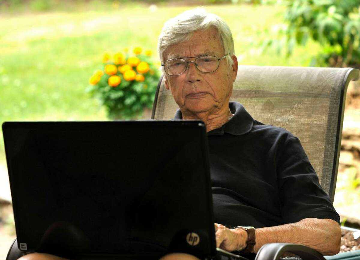 Forrest Palmer works with a laptop computer on the patio of his Southbury home on Thursday, July 8, 2010. He recently received a lifetime achievement award from the Connecuticut Council on Freedom of Information.