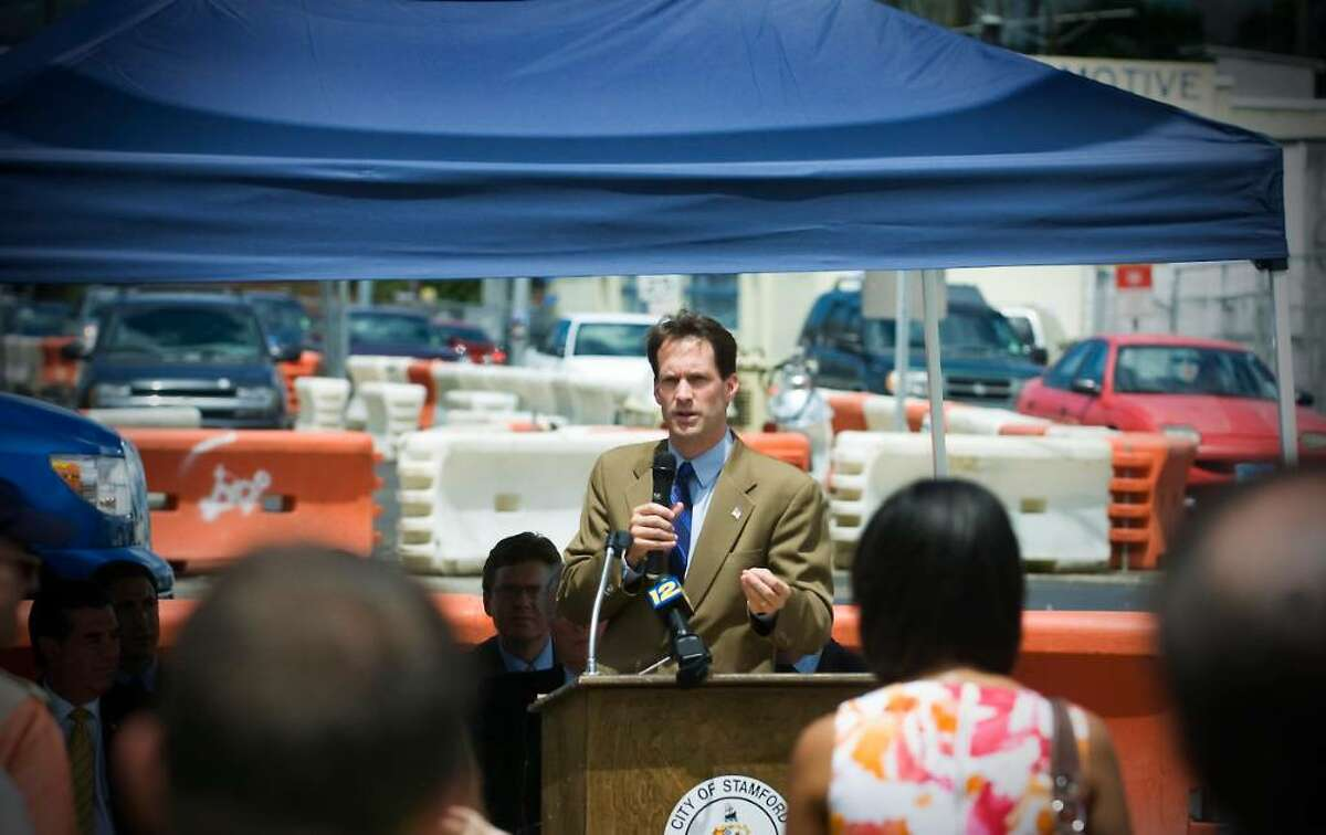 U.S. Rep. Jim Himes, D-Greenwich, announces a $16 million federal grant to the Urban Transitway during a press conference at the corner of Myrtle Avenue and Elm Street in Stamford, Conn. on Friday July 9, 2010.