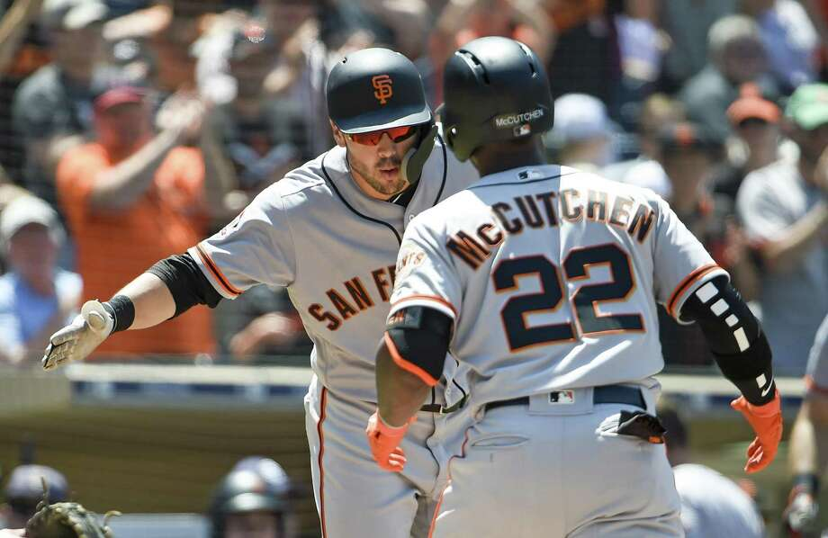 Andrew McCutchen (22) of the San Francisco Giants is congratulated by Chase d'Arnaud  after hitting  a solo home run during the fifth inning of a baseball game against the San Diego Padres PETCO Park on July 31, 2018 in San Diego, California.  Photo: Denis Poroy / Getty Images / 2018 Getty Images