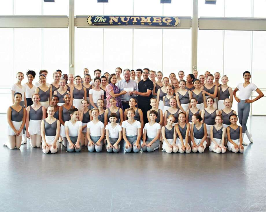 Stephen Silver, community relations specialist from Eversource, presents a check for $1,000 to Victoria Mazzarelli, Nutmeg's artistic director; and Tim Melady, principal ballet master, before a group of young students from Nutmeg's first summer intensive workshop of 2018. Photo: Kim Fazzino / Contributed Photo