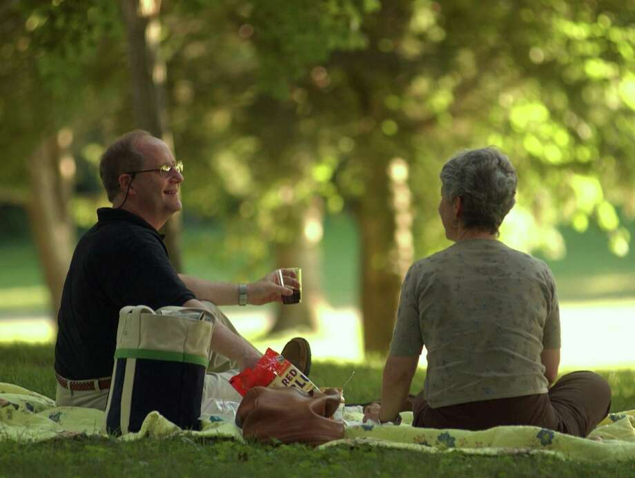 Concertgoers picnic on the Ellen Battell Stoeckel Estate grounds in 2003. During Weekend in Norfolk, Aug. 3-5, picnicking is one of many activities likely around town. Photo: Peter Hvizdak / Hearst Connecticut Media