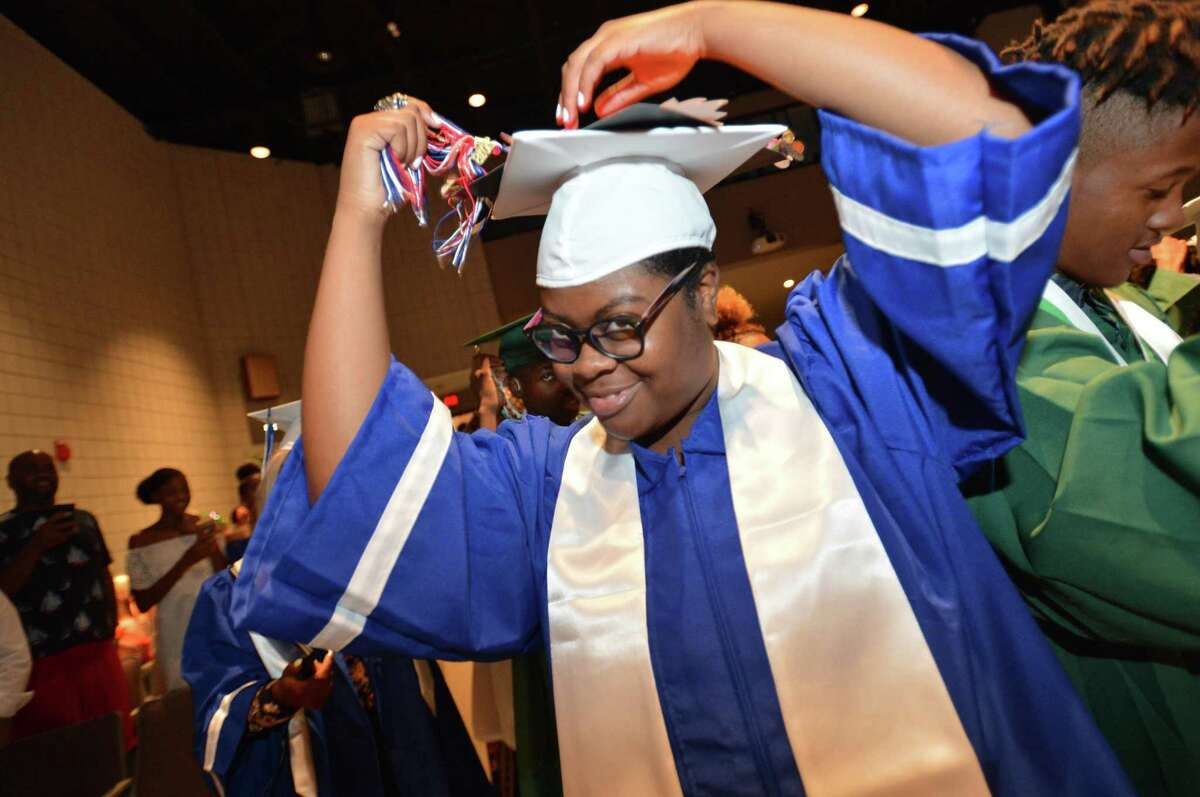 Brien McMahon graduate Ashaunti Hodrick moves her tassel with others during Class of 2018 Summer Graduation Exercises of Brien McMahon and Norwalk High Schools at Norwalk Community College, Tuesday July 31, 2018 in Norwalk Conn