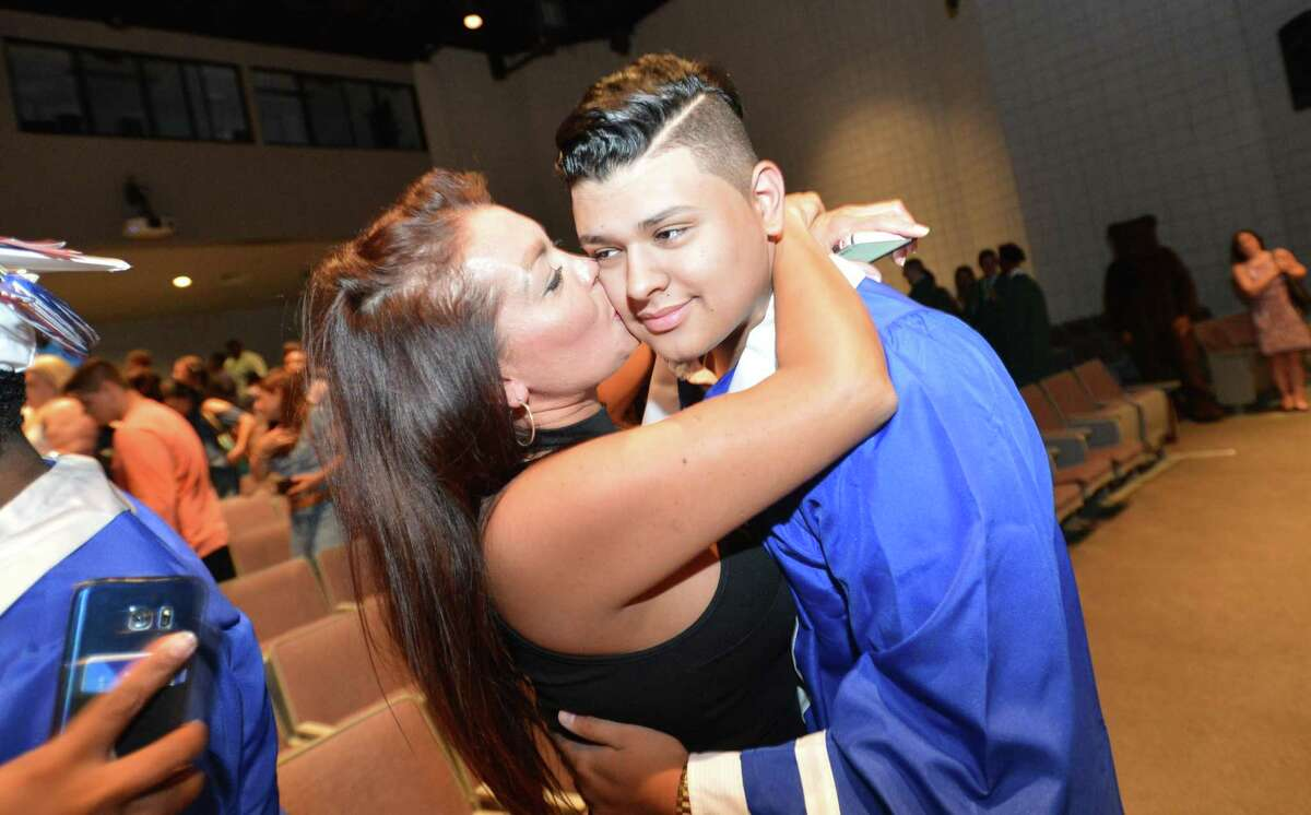 Brien McMahon graduate Luis Avalos gets a hug from his mom Gabriella during Class of 2018 Summer Graduation Exercises of Brien McMahon and Norwalk High Schools at Norwalk Community College, Tuesday July 31, 2018 in Norwalk Conn