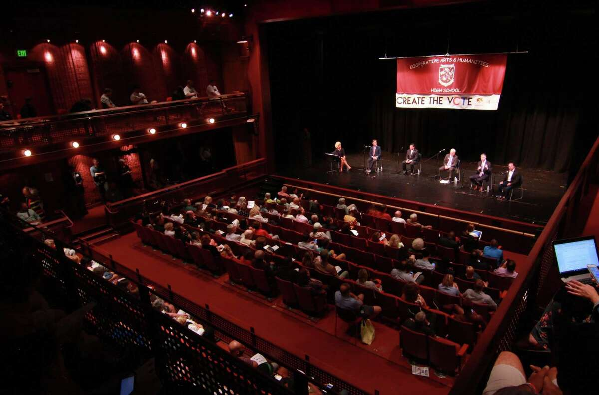 Gubernatorial candidates attend the Create the Vote forum held at the Cooperative Atrs & Humanities High School in New Haven, Conn., on Tuesday July 31, 2018. The moderator is WTNH's Ann Nyberg, at left on stage. Attending the forum from left to right is Ned Lamont, Tim Herbst, Oz Griebel, David Stemerman and Joe Ganim.