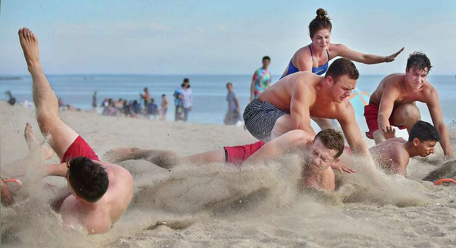 Connecticut State Parks' lifeguards compete at the Connecticut Department of Energy and Environmental Protection State Park Division annual lifeguard competition at East Beach at Hammonasset Beach State Park in Madison, Tuesday July 31, 2018. The teams competed in a range of events from assembling a proper medical bag to a run-swim-board relay to backboarding. Photo: Catherine Avalone, Hearst Connecticut Media / New Haven Register