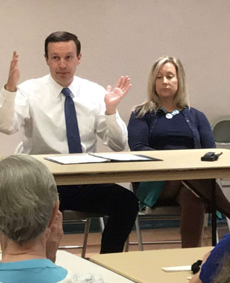 U.S. Sen. Chris Murphy, D-Conn., left, speaks in Cheshire Tuesday. Photo: Luther Turmelle / Hearst Connecticut Media
