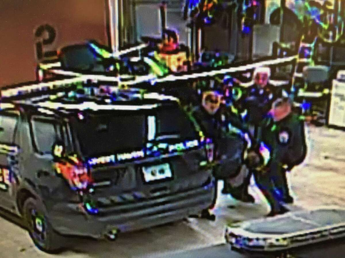 In this image from video, West Haven police officer Joseph Riehl, left, assisted by two other officers, takes down Albert Stober, a homeless man, while trying to subdue Stober and take him into custody on Jan. 29, 2018.