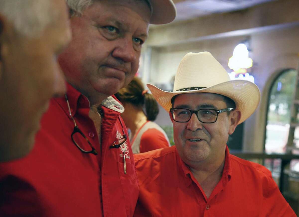 Republican Pete Flores,R, after finding out he has taken second place behind Pete Fallen. On the left is Terry Beck, Larry Sitter,middle. Republican Pete Flores, a retired Texas game warden, is holding his SD19 election night watch party at Don Pedro Mexican Restaurant, 1526 SW Military Dr. on Tuesday, July 31, 2018.