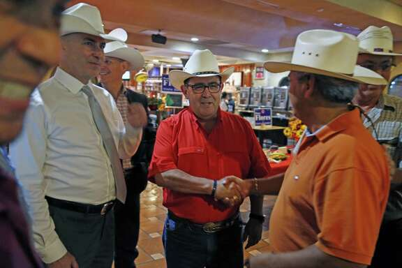 Pete Flores receives congratulations from supporters after he took the lead for the first time. Republican Pete Flores, a retired Texas game warden, is holding his SD19 election night watch party at Don Pedro Mexican Restaurant, 1526 SW Military Dr. on Tuesday, July 31, 2018.