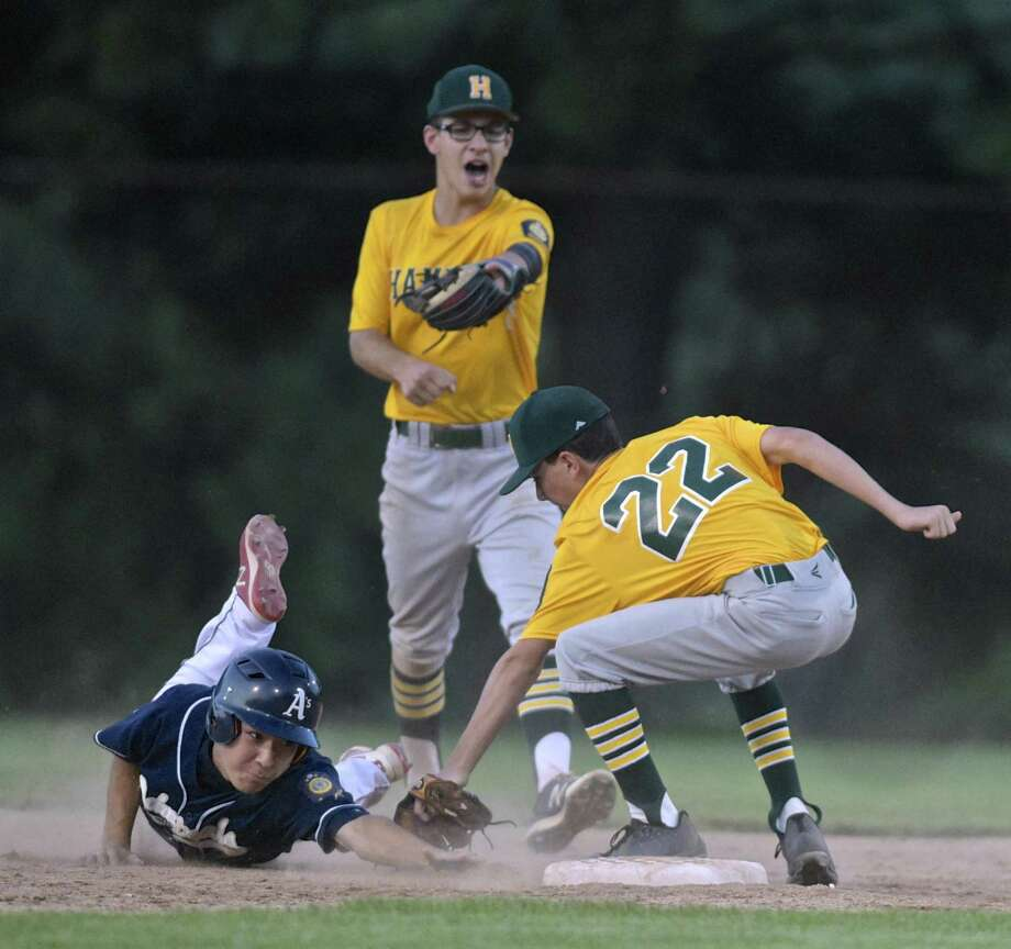 Hamden's Matthew Desroches (22) tags out Bethel's Shawn Sato at second, with a little direction from Hamden teammate Jake Jovia in the Legion U17 state tournament Tuesday at Hunts Field, Bethel. Photo: H John Voorhees III / Hearst Connecticut Media / The News-Times
