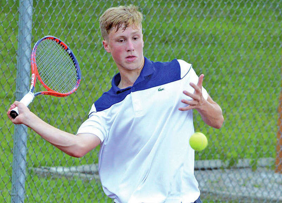 Alton Marquette junior A.J. Bower returns a shot on Tuesday during his first-round match in the Pro Wildcard Challenge at the Edwardsville High School Tennis Center. Photo:     Scott Marion | For The Telegraph