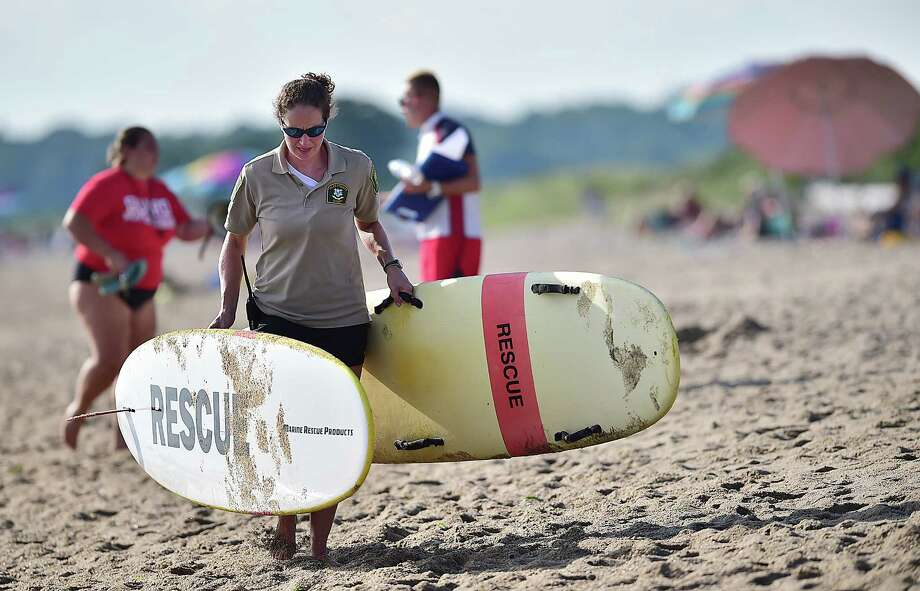 The Connecticut Department of Energy and Environmental Protection State Park Division annual lifeguard competition at East Beach at Hammonasset Beach State Park in Madison, Tuesday July 31, 2018. The teams from the Connecticut State Parks competed in a range of events from assembling a proper medical bag to a run-swim-board relay to backboarding to win the Trident Cup. Photo: Catherine Avalone, Hearst Connecticut Media / New Haven Register