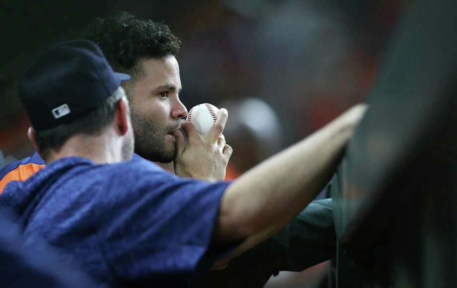 PHOTOS: A look at the Astros' win on Tuesday night Houston Astros second baseman Jose Altuve (27) watches the Astros take on the Texas Rangers from the dugout at Minute Maid Park on Friday, July 27, 2018 in Houston. Rangers won the game 11-2. Photo: Elizabeth Conley, Staff Photographer / Houston Chronicle / © 2018 Houston Chronicle