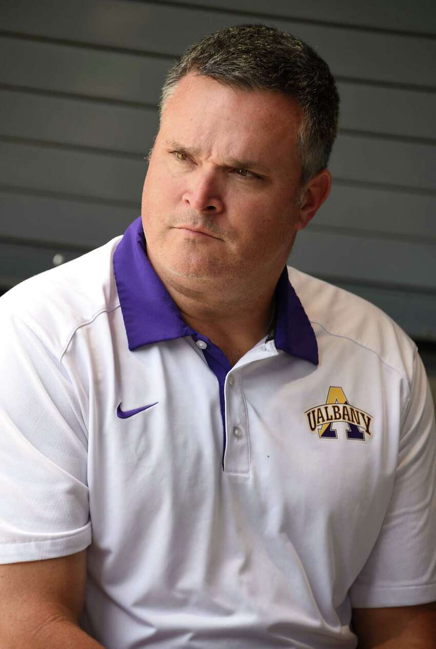 Defensive coordinator Keith Dudzinski talks to a reporter as the University at Albany football team holds their media day on Tuesday July 31, 2018 in Albany, N.Y. (Lori Van Buren/Times Union)