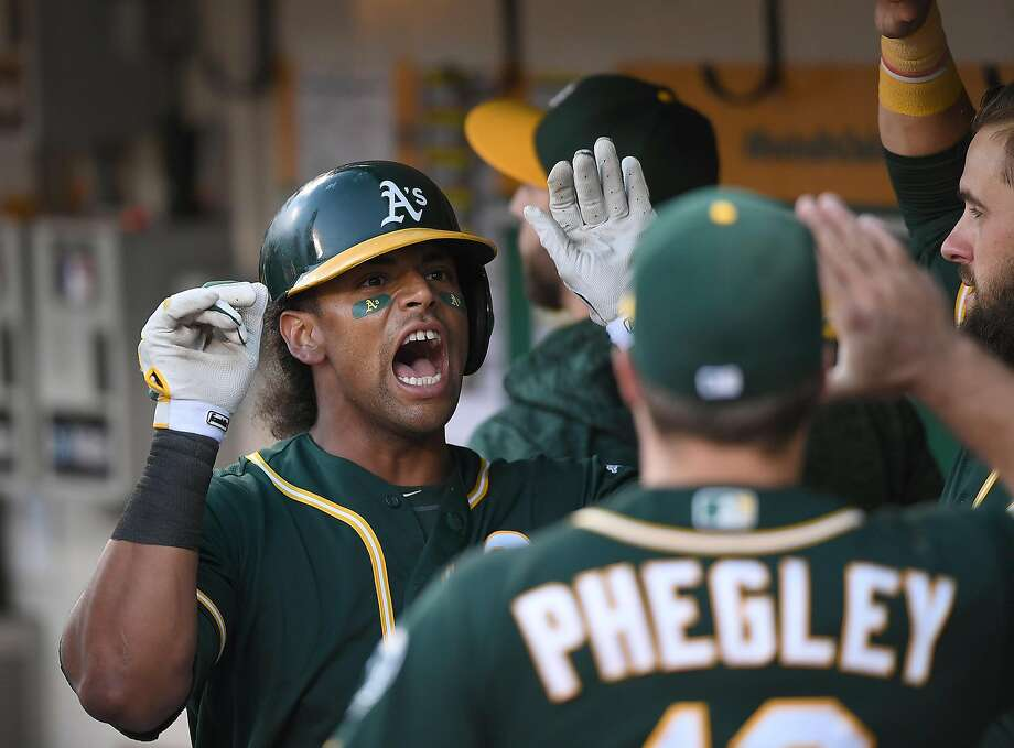 Khris Davis of the Oakland Athletics is congratulated by teammates after he hit a solo home run against the Toronto Blue Jays in the bottom of the third inning at Oakland Alameda Coliseum on July 31, 2018. Photo: Thearon W. Henderson / Getty Images