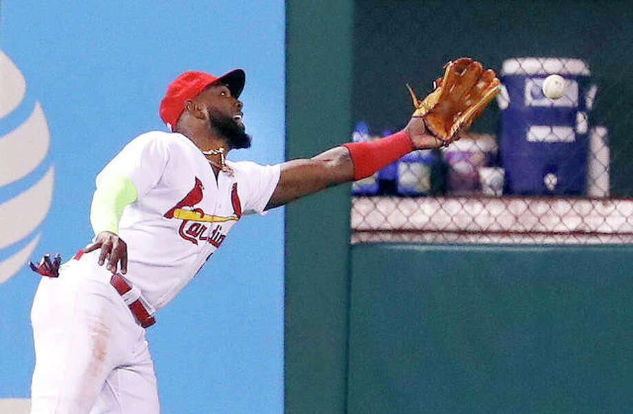 Cardinals left fielder Marcell Ozuna is unable to catch an RBI double by the Rockies' Trevor in the sixth inning of Tuesday's game in St. Louis. Photo:       Jeff Roberson | AP Photo