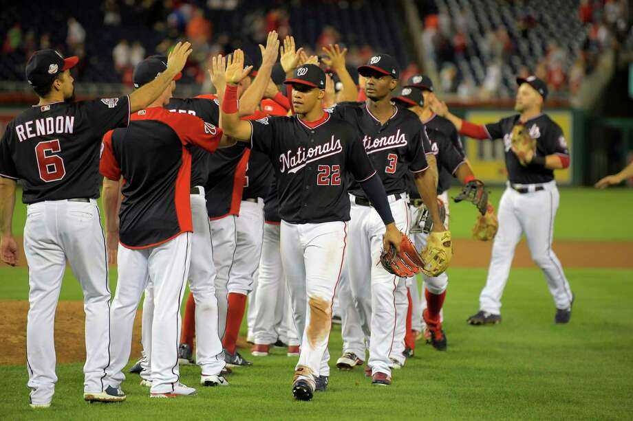 The Nationals celebrate a 25-4 win over the New York Mets, a victory that came just hours after the trade deadline passed without them making any major moves apart from dealing reliever Brandon Kintzler for a minor leaguer. Photo: Washington Post Photo By John McDonnell / The Washington Post