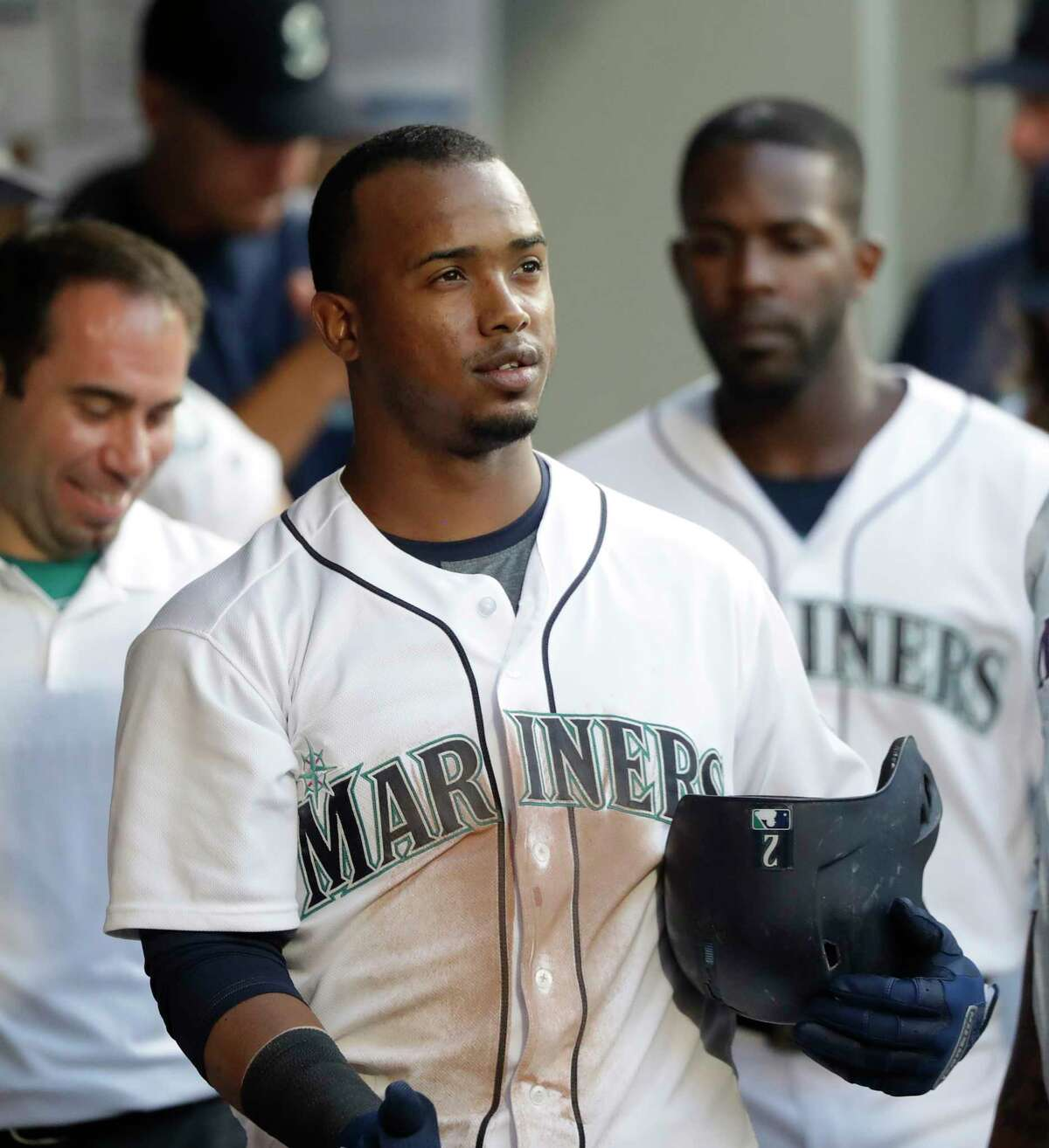 Seattle Mariners' Jean Segura smiles in the dugout after his home run against the Houston Astros in the fourth inning of a baseball game Tuesday, July 31, 2018, in Seattle. (AP Photo/Elaine Thompson)