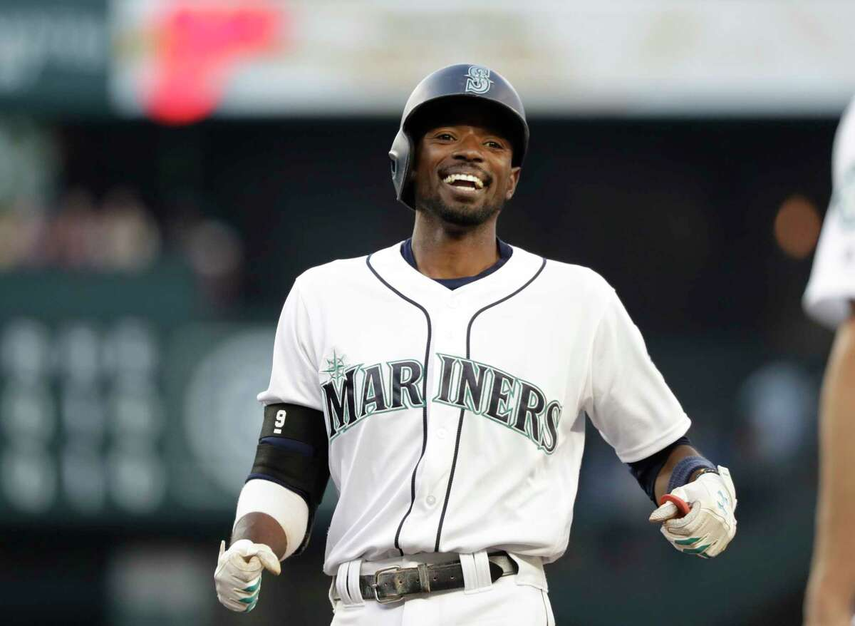 Seattle Mariners' Dee Gordon smiles during a baseball game against the Houston Astros Tuesday, July 31, 2018, in Seattle. (AP Photo/Elaine Thompson)