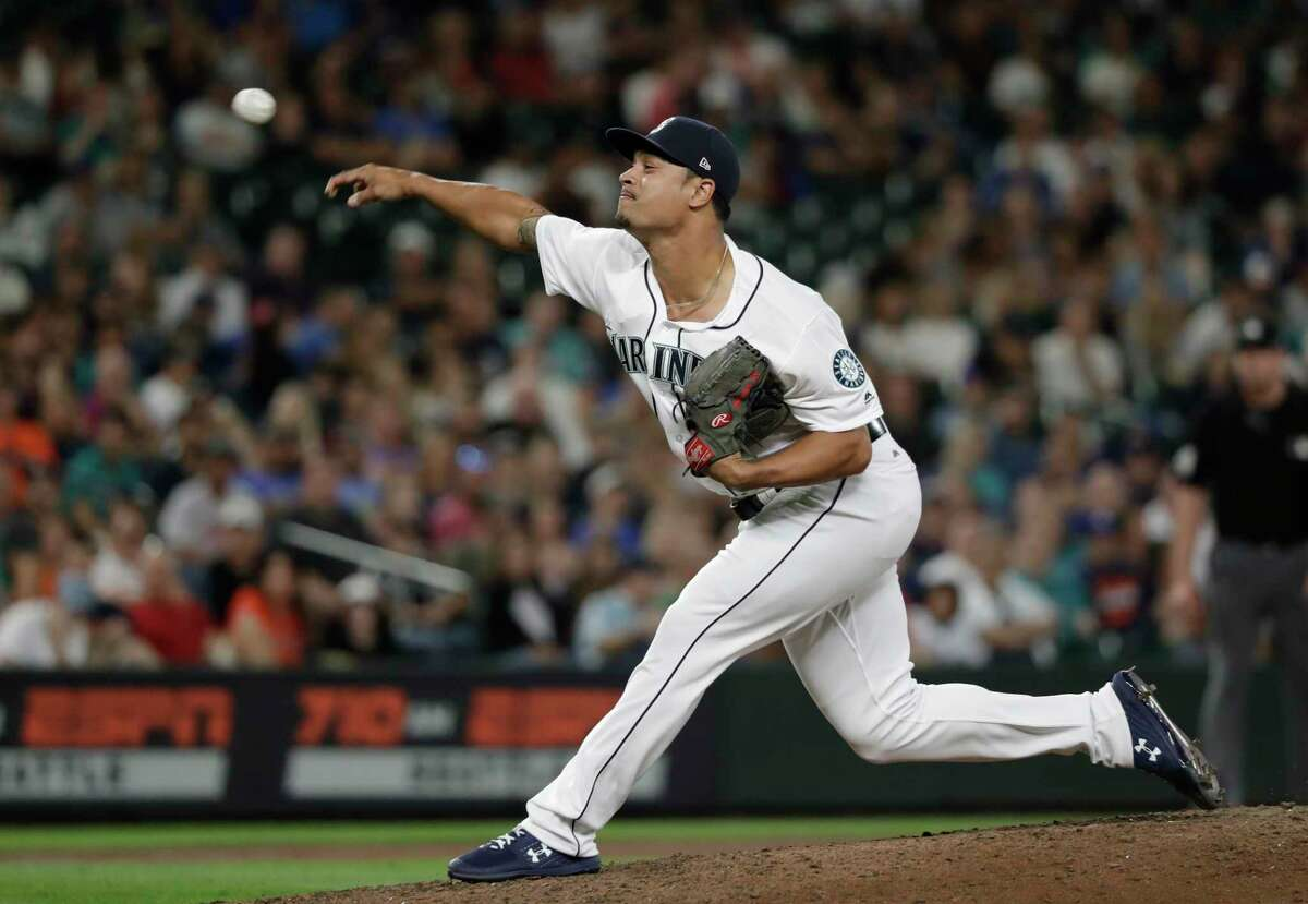 Seattle Mariners relief pitcher Sam Tuivailala throws against the Houston Astros in a baseball game Tuesday, July 31, 2018, in Seattle. (AP Photo/Elaine Thompson)