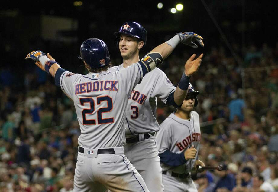 SEATTLE, WA - JULY 31:  Josh Reddick #22 of the Houston Astros celebrates his home run with Kyle Tucker #3, who scored, in the ninth inning against the Seattle Mariners at Safeco Field on July 31, 2018 in Seattle, Washington. Photo: Lindsey Wasson, Getty Images / 2018 Getty Images
