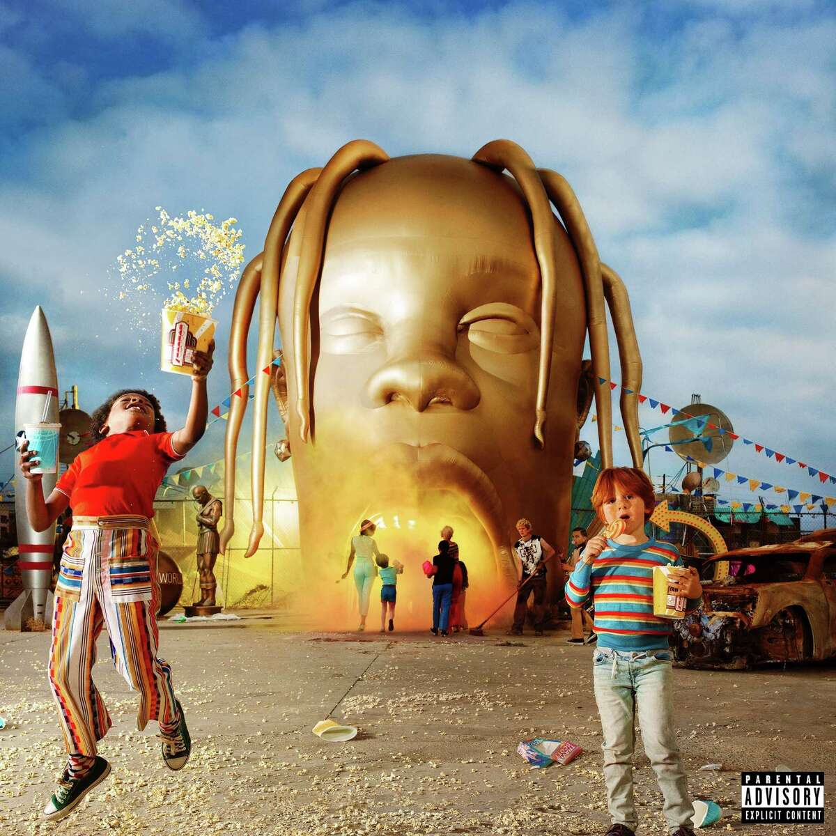 BACK AT IT: Travis Scott does more fan service via Twitter The Houston-born rapper, Travis Scott offered to design the senior shirts for a local high school after seeing a tweet from a student asking permission to use album art from