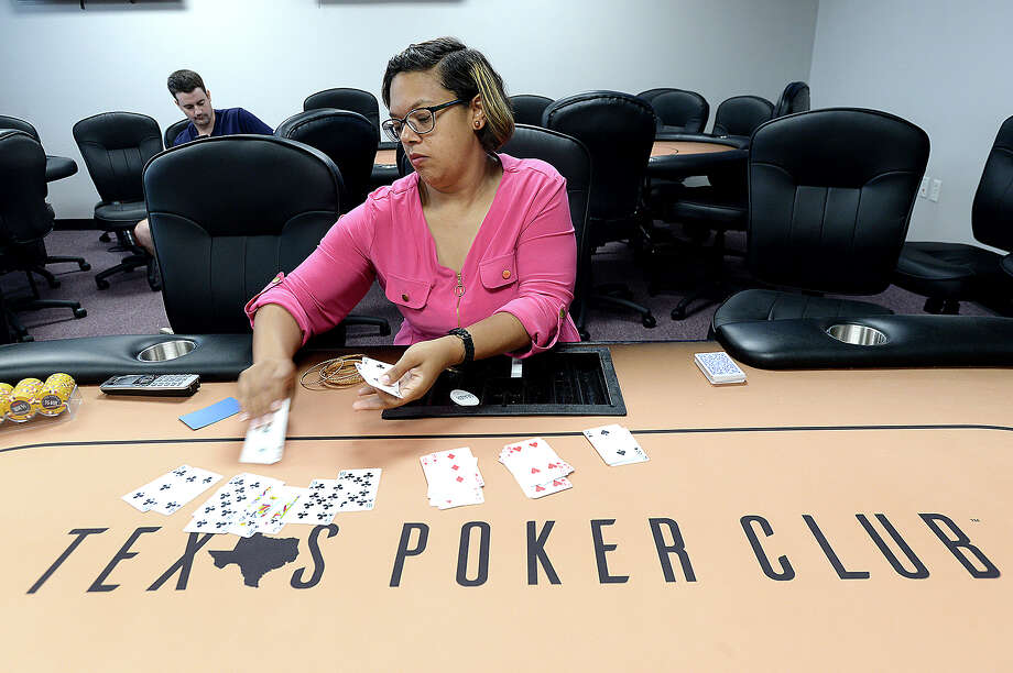 Kayla Ledet, a 12-year professional dealer at L'Auberge Casino in Lake Charles, sorts through a deck of cards after stopping to fill out paperwork for her new job dealing at Texas Poker Club in Beaumont, which opens Friday, August 3. The social club already has over 30 members signed up and can accommodate 40 players. In addition to poker, the club will hold special events for major sports tournaments and fantasy football.  Owner Lane Helveston, who was a career professional poker player, says the club will be staffed by professional dealers with years of casino experience, as well as offer a hostess for BYOB drink service and a contracted food truck on site. Tuesday, July 31, 2018 Kim Brent/The Enterprise Photo: Kim Brent/The Enterprise