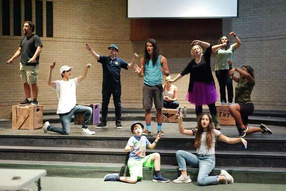 The cast of Godspell rehearses for a production by Home Grown Theatre that will be performed at Memorial Baptist Church in Pasadena.