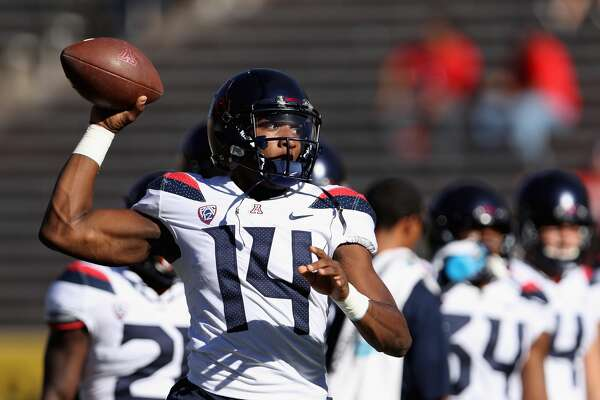 TEMPE, AZ - NOVEMBER 25: Quarterback Khalil Tate #14 of the Arizona Wildcats warms up before the college football game against the Arizona State Sun Devils at Sun Devil Stadium on November 25, 2017 in Tempe, Arizona. (Photo by Christian Petersen/Getty Images)