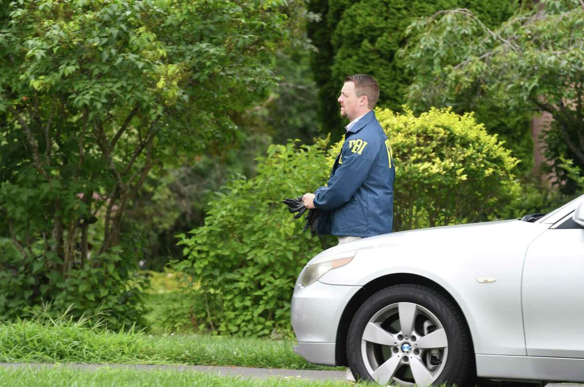 Federal agents search a home at 8 Cephalonia Drive on Wednesday, Aug. 1, 2018, in Niskayuna, N.Y. Agents from Homeland Security Investigations, a division of the federal Department of Homeland Security, are also on the scene (Will Waldron/Times Union)