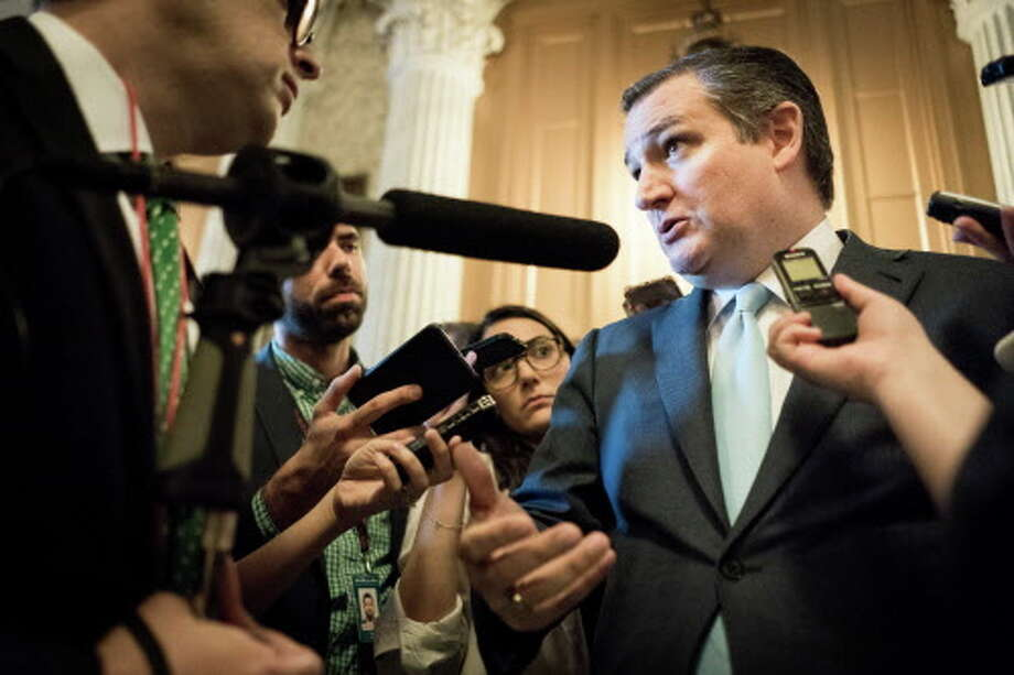 Sen. Ted Cruz talks to reporters in June on Capitol Hill in Washington. Cruz continues to hold a slim margin over challenger Beto O'Rourke. Photo: ERIN SCHAFF, NYT / NYTNS