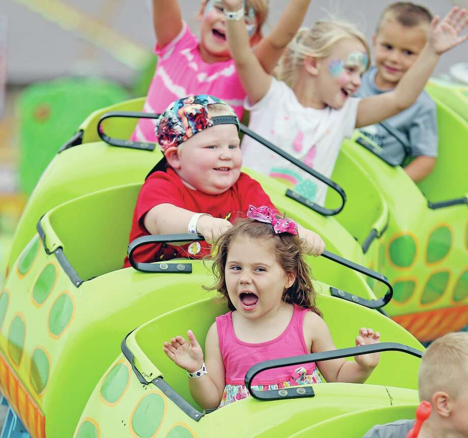 Estee Emery, 2, of Caro, was excited to take a spin on the Crocodile Mile, Tuesday, at the 150th Huron Community Fair. (Paul P. Adams/Huron Daily Tribune) Photo: Paul P. Adams/Huron Daily Tribune