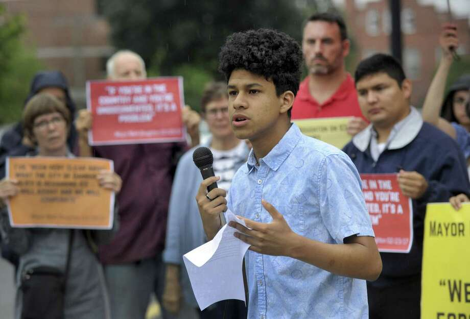 Nelson Neira, 17, of Danbury, with CT Students 4 A Dream, speaks at a 8 a.m. rally at Danbury City Hall Wednesday morning, August 1, 2018.  CT Students 4 A Dream  and the ACLU will held a rally/press conference outside Danbury City Hall  to protest recent ICE arrests in the area and slam Mayor Mark Boughton for cooperating with federal immigration authorities just two weeks out from the hotly contested GOP gubernatorial primary. Photo: Carol Kaliff / Hearst Connecticut Media / The News-Times