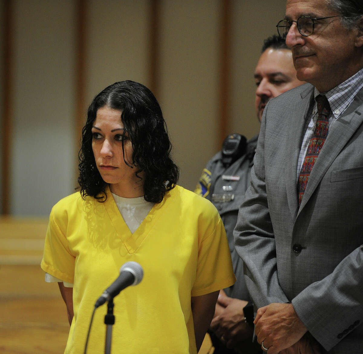 Standing with her lawyer Norman Pattis, right, Jennifer Valiante, Kyle Navin's girlfriend, is sentenced to sixteen years, suspended after eight years, for her role in the murder of Navin's parents, in Superior Court in Bridgeport, Conn. on Wednesday, August 1, 2018.